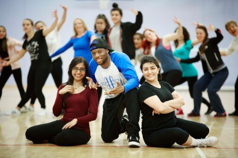 Brendan 'Syxx' Isaac from Boy Blue Entertainment in London teaching street dance to to people participation in Mini Burble, Pictured with L-R Chandi Patel and Solmaz Rohani both from Salford