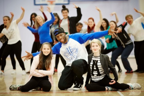 Brendan 'Syxx' Isaac from Boy Blue Entertainment in London teaching street dance to to people participation in Mini Burble, Pictured with L-R Freya Maran and Sophie Cutler both from Heaton Norris Stockport